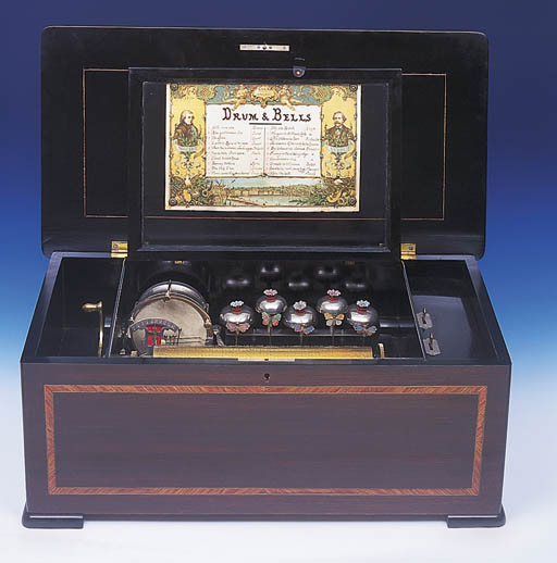 A DRUM AND BELLS MUSICAL BOX