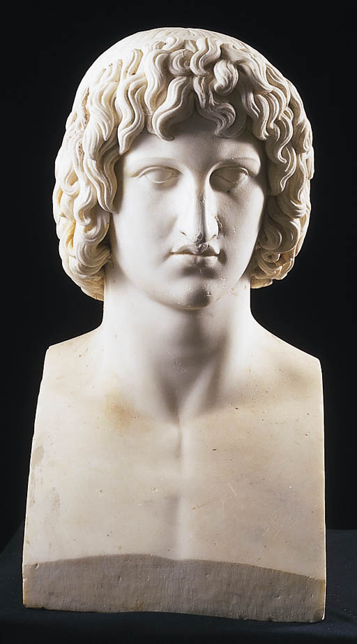 A MARBLE BUST OF A YOUNG MAN W
