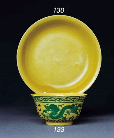 A CHINESE YELLOW GLAZED SAUCER