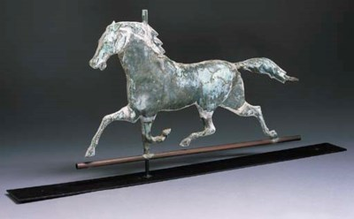 A MOLDED COPPER TROTTING HORSE