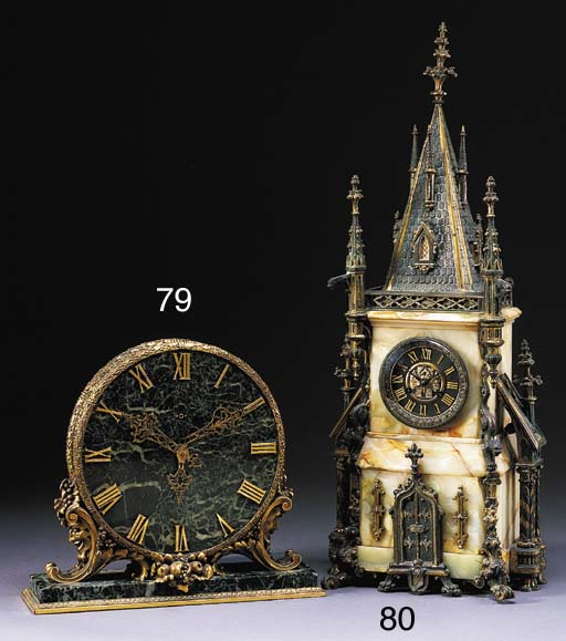 A GOTHIC REVIVAL ONYX AND GILT METAL MANTLE CLOCK