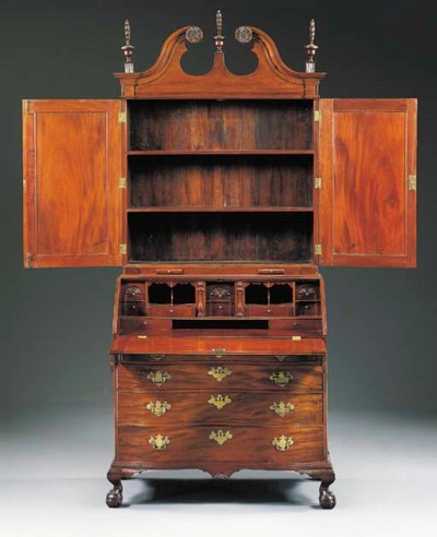 A CHIPPENDALE MAHOGANY DESK-AN