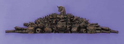 AN ENGLISH CARVED OAK OVERDOOR