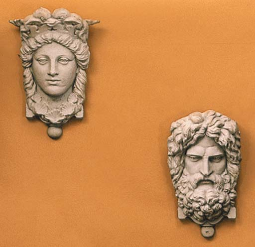 A PAIR OF TERRACOTTA-PAINTED C