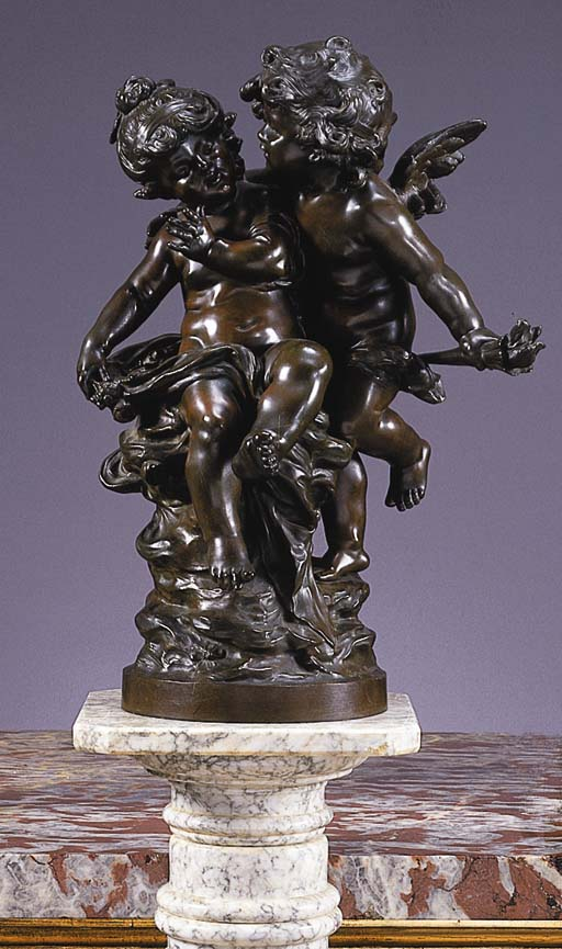 A FRENCH BRONZE GROUP OF CUPID