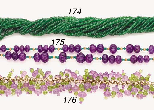 AN AMETHYST, EMERALD AND GOLD