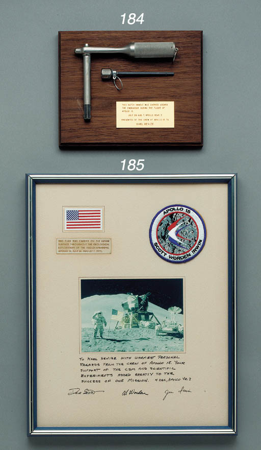 """FLOWN Flight Tool from Apollo 15. A Hatch handle and CPC driver. Flight wrench approx. 7 in. long with a 5 in. shaft and flight hex driver approx. 5 in. long connecting at the end of wrench. Mounted on a wood base with plaque that reads: """"This hatch handle was carried aboard the Endeavour during the flight of Apollo 15.  July 26 - Aug. 7, Apollo Year 3. Presented by the crew of Apollo 15 to Karl Henize."""" Both tools have inspection stamps and part numbers. The hatch handle was also known as """"tool B"""" and CPC (Cold Plate Clamp) as """"tool L"""" in the flight tool set. These tools were used during the flight, and in particular these and others during a water leak fix that Henize communicated to the crew from his CAPCOM position during the flight. The tools were given to Henize as a memento after the flight. [With:] A four-page set of illustrations and text describing Apollo flight tools.  (6)"""