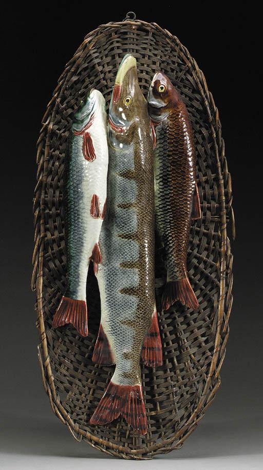 A MAJOLICA MODEL OF THREE FISH