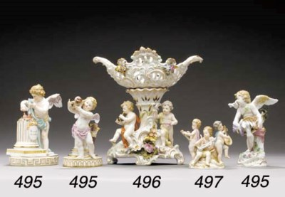 A MEISSEN FIGURE OF A PUTTO EM