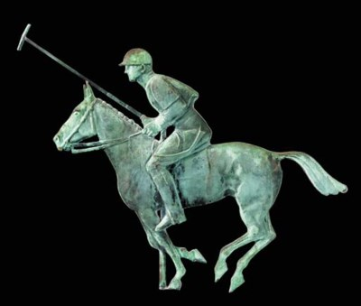 A MOLDED COPPER POLO PLAYER WE