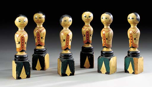 A SET OF SIX CARVED AND PAINTE