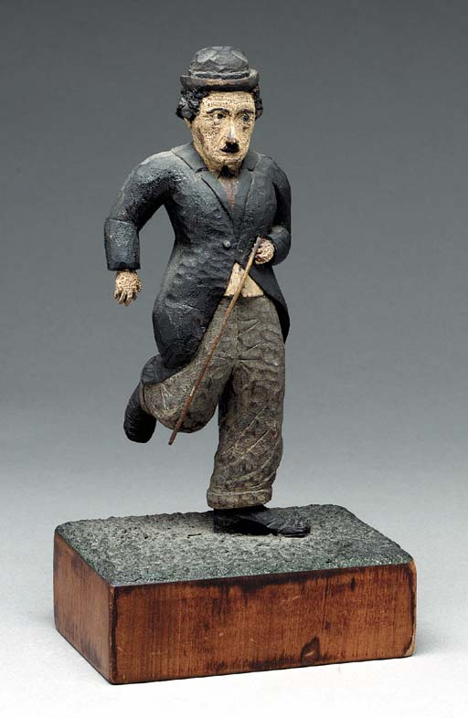 A CARVED AND PAINTED FIGURE OF