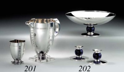 A SILVER WATER PITCHER AND MAT