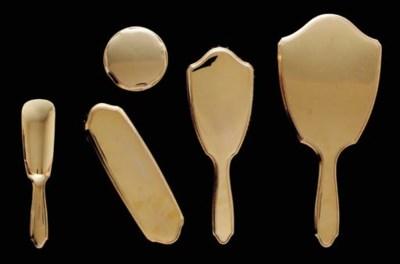 A FIVE-PIECE GOLD DRESSER SET