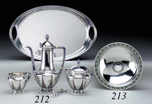 A FOUR-PIECE SILVER AND ENAMEL