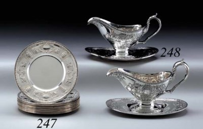 A SET OF TWELVE SILVER BREAD A