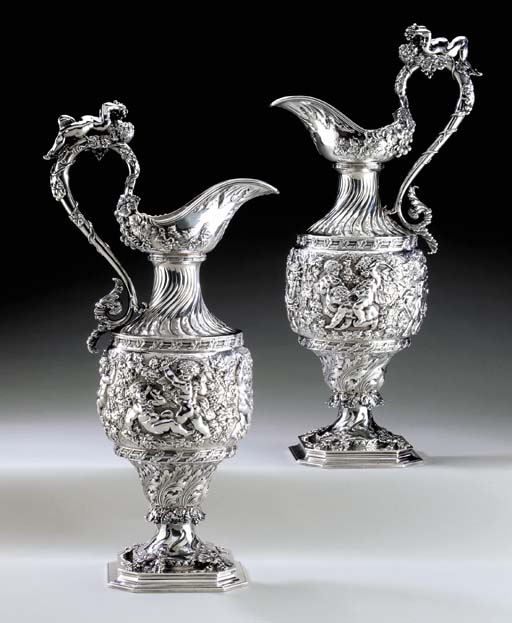 A PAIR OF LARGE SILVER EWERS
