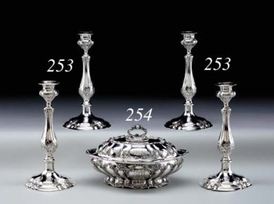 A SILVER VEGETABLE DISH WITH C