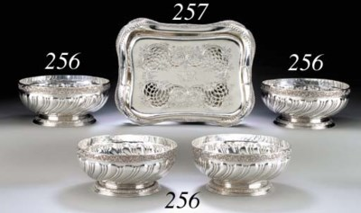 A SET OF FOUR SILVER BOWLS