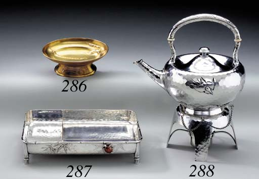 A SILVER KETTLE ON STAND WITH