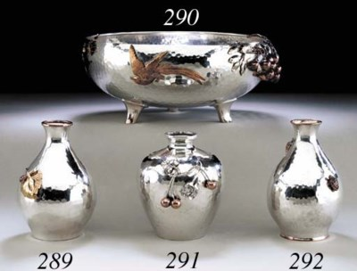 A SILVER AND MIXED-METAL BOWL