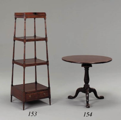 A REGENCY MAHOGANY FOUR-TIER W