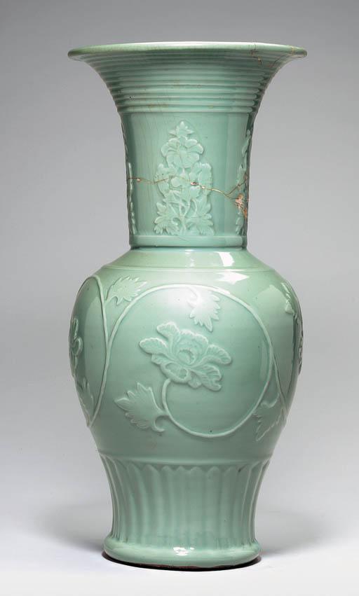 A Large Celadon Molded Yenyen