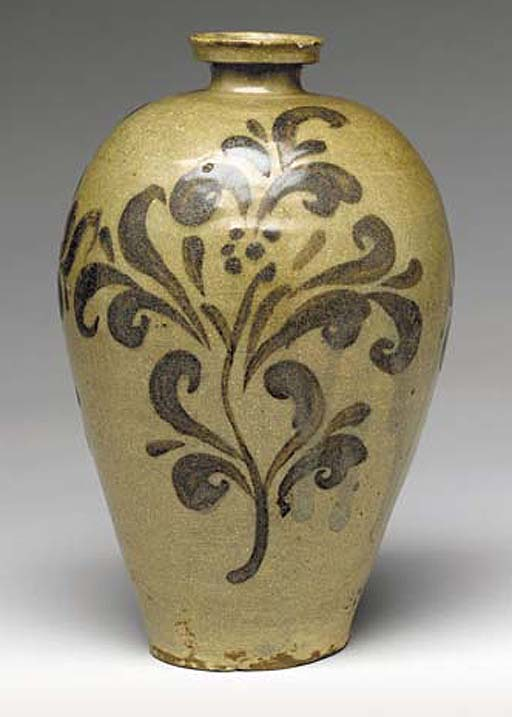 An Iron and Celadon-Decorated