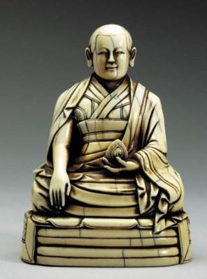 An Ivory Figure of a Lama