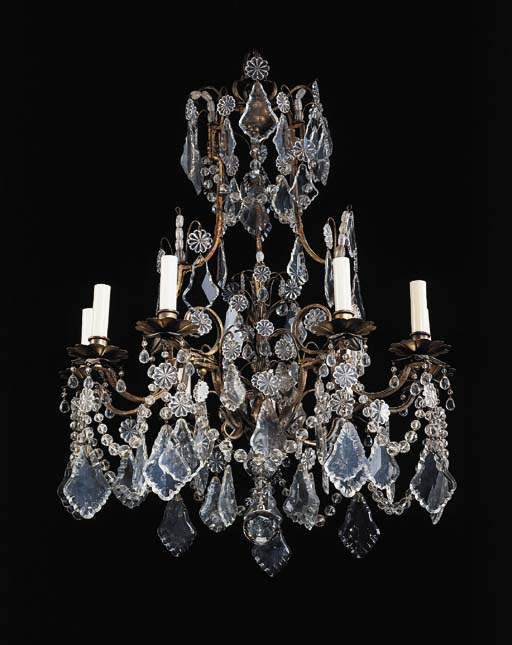 A LOUIS XV STYLE ROCK CRYSTAL, CUT-GLASS AND GILT-METAL TWELVE-BRANCH CHANDELIER