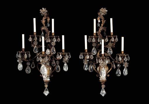 A PAIR OF LOUIS XV STYLE GILT-METAL, ROCK CRYSTAL AND CUT-GLASS FIVE-BRANCH WALL-LIGHTS