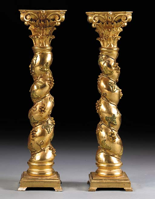 A PAIR OF ITALIAN BAROQUE STYLE GILTWOOD COLUMNS