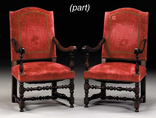 A SET OF FOURTEEN LOUIS XIII STYLE WALNUT DINING CHAIRS