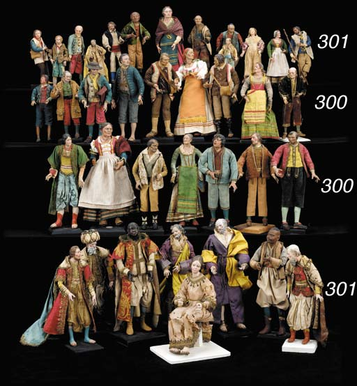 A GROUP OF SIXTEEN POLYCHROME-