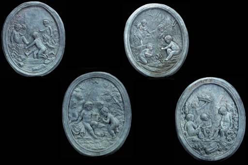 A SET OF FOUR FRENCH LEAD PLAQ