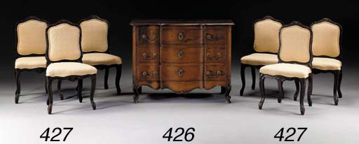 A SET OF SIX LOUIS XV PROVINCIAL STAINED WALNUT CHAISES