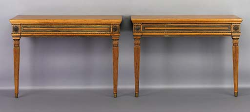 A PAIR OF NORTH EUROPEAN NEOCLASSIC GILT-BRASS-MOUNTED BIRCH CONSOLE TABLES