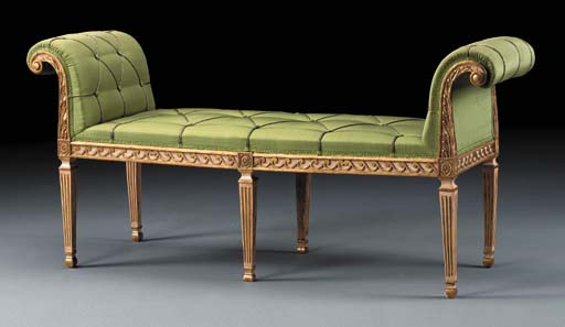 A GEORGE III PARCEL-GILT AND C