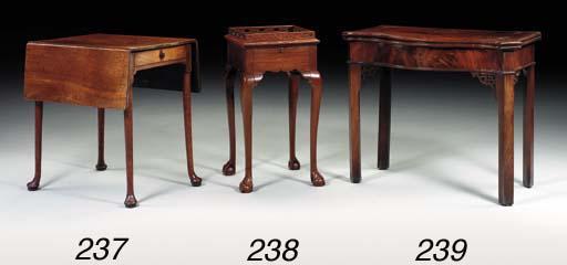A GEORGE II MAHOGANY URN TABLE
