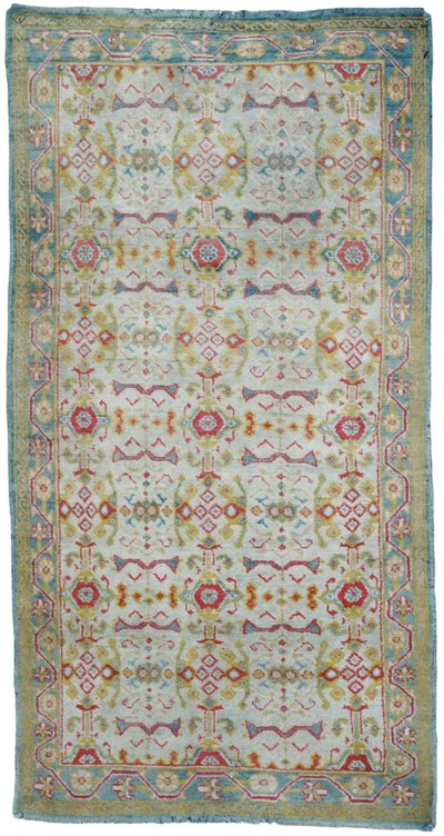 A COTTON AGRA RUG