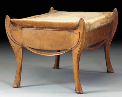 A CARVED PEARWOOD STOOL*