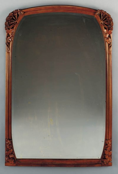 A LARGE CARVED MAHOGANY MIRROR