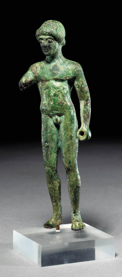 A GREEK BRONZE KOUROS