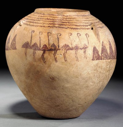 AN EGYPTIAN POTTERY JAR