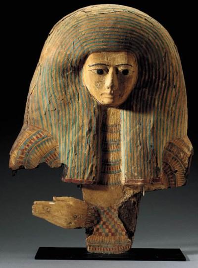 AN EGYPTIAN WOOD MASK