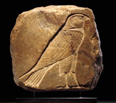 AN EGYPTIAN QUARTZITE SCULPTOR