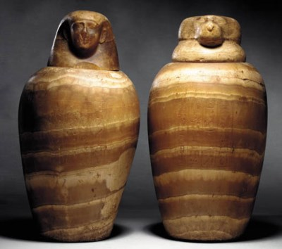 TWO EGYPTIAN ALABASTER CANOPIC