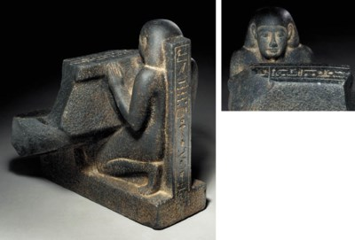 AN EGYPTIAN BASALT FIGURE WITH