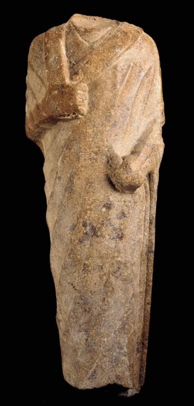 AN EGYPTIAN QUARTZITE DRAPED M