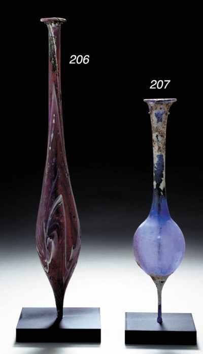 A ROMAN MARBLED GLASS FLASK